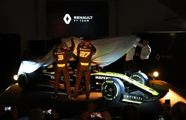 Renault mechanics unveil the latest car which Ricciardo will be desperate is more reliable than his Red Bull last year