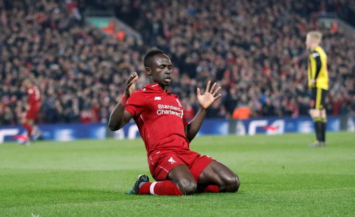 Sadio Mane scored twice as Liverpool beat Watford to stay top of the league