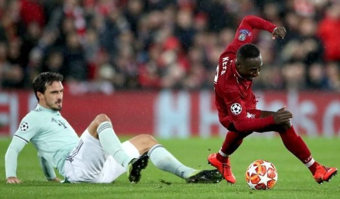 Bayern Munich's Mats Hummels slides in on Naby Keita during the 0-0 Champions League draw