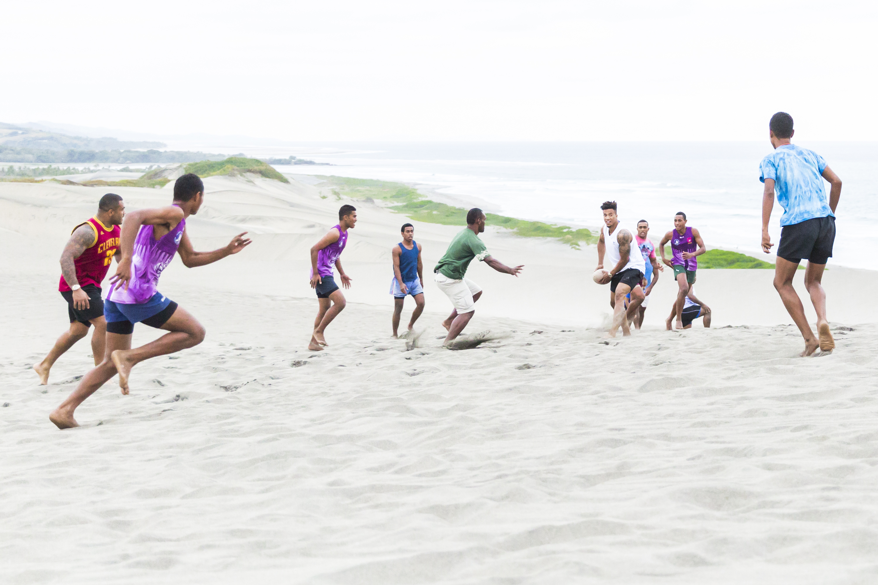 Anthony Watson enjoying a game of rugby with locals at Fiji's Sigatoka Sand Dunes National Park
