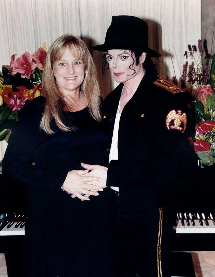 Michael Jackson and his new wife Debbie Rowe pose for a wedding photo minutes