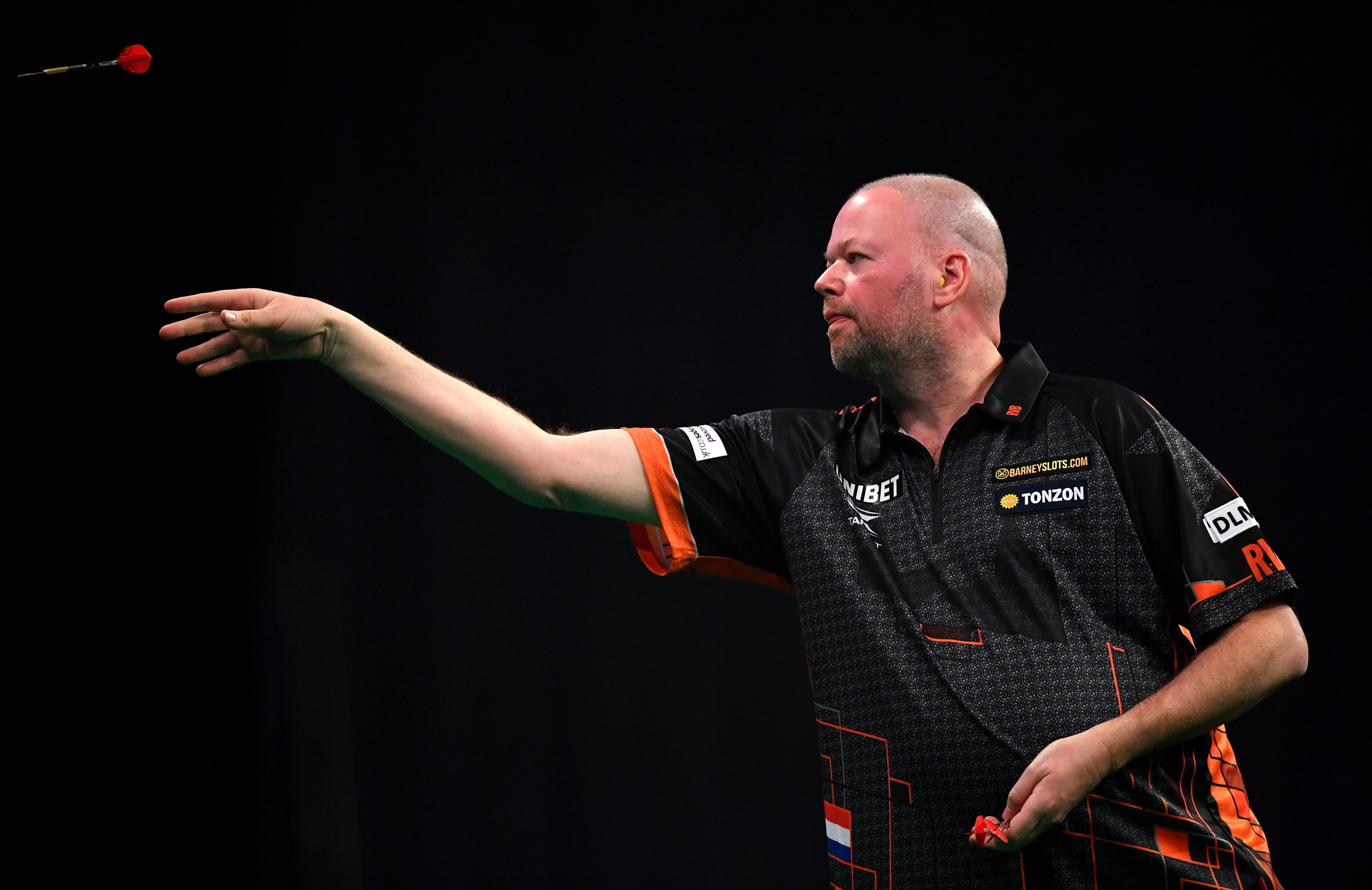 Darts icon Raymond van Barneveld's was on the brink of a divorce before he was snapped kissing a mystery blonde