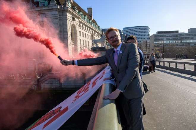 Lloyd Russell-Moyle and Mr Lewis could face fines of up to £5,000 as it seen as an offence to throw or discharge smoke bombs in public
