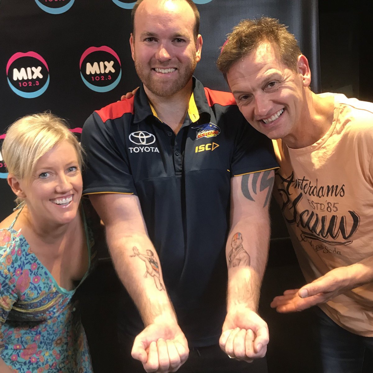 Griffiths with Jodie & Soda pair Jodie Oddy and Mark Soderstrom after getting the inking done