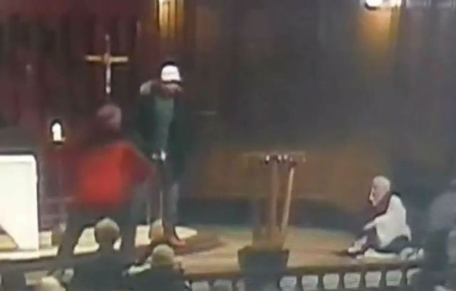 Members of the congregation get to their feet and challenge the knifeman