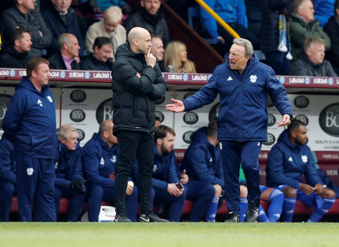 Warnock raged at the fourth official who convinced ref Mike Dean to overturn the decision