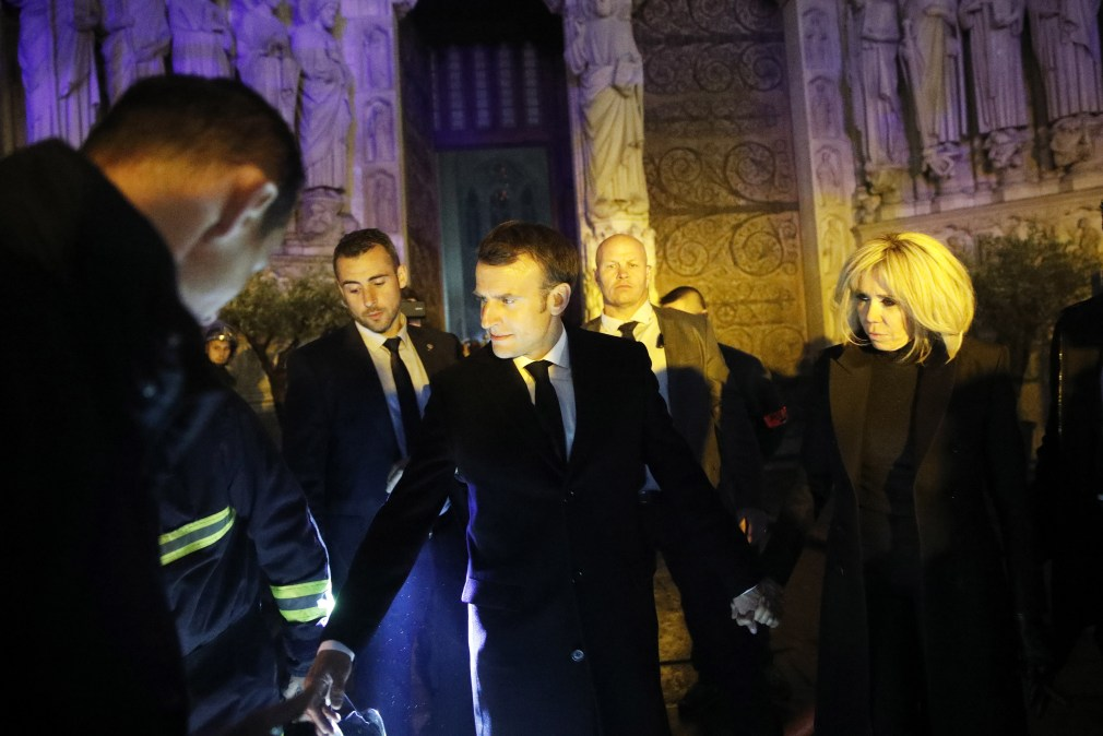 Emmanuel Macron, centre, and his wife Brigitte visited the cathedral last night