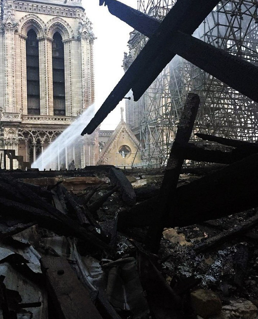 The charred ruins of the inside of the cathedral were visible at day break