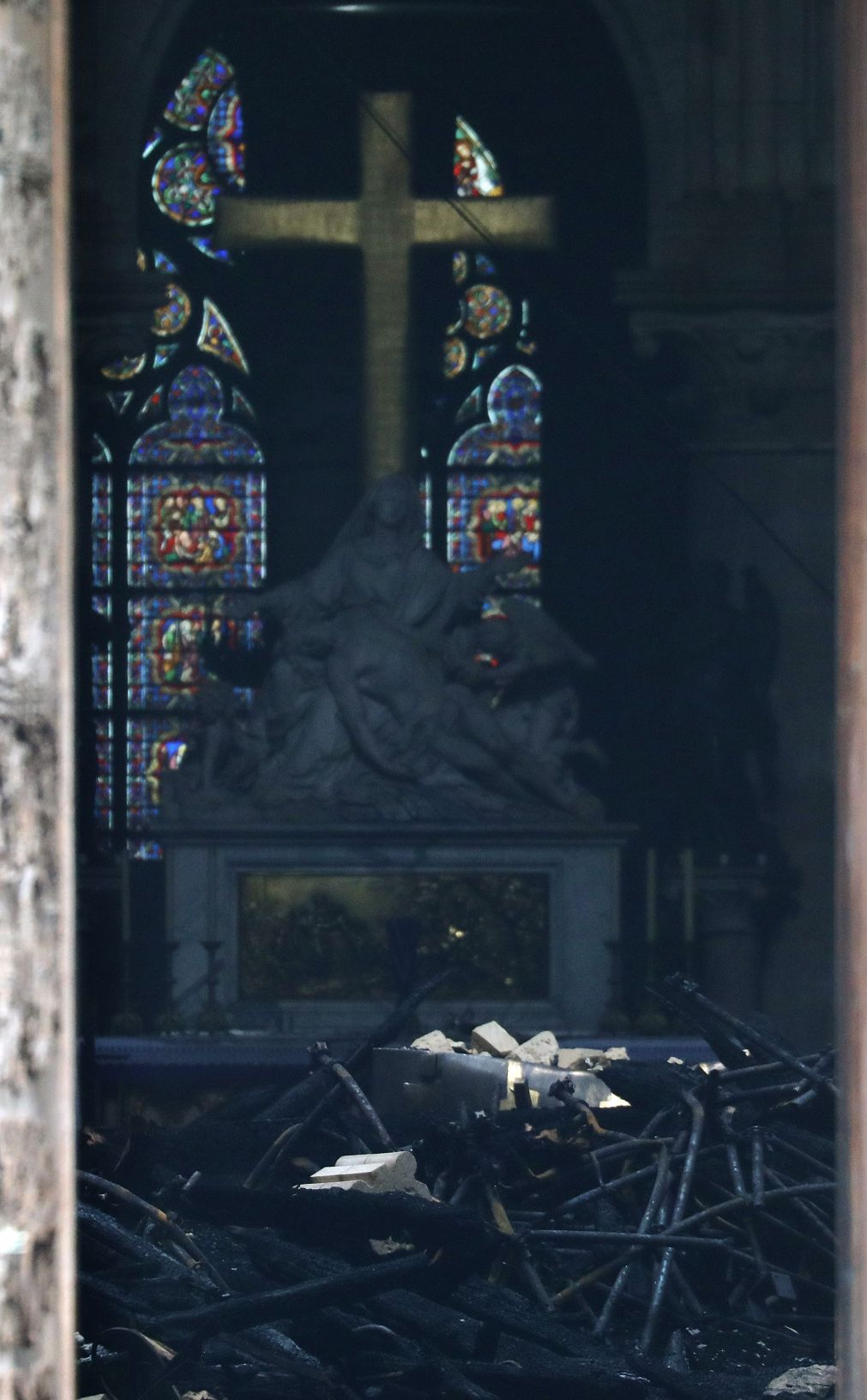 The open door of the cathedral reveals the damage inside