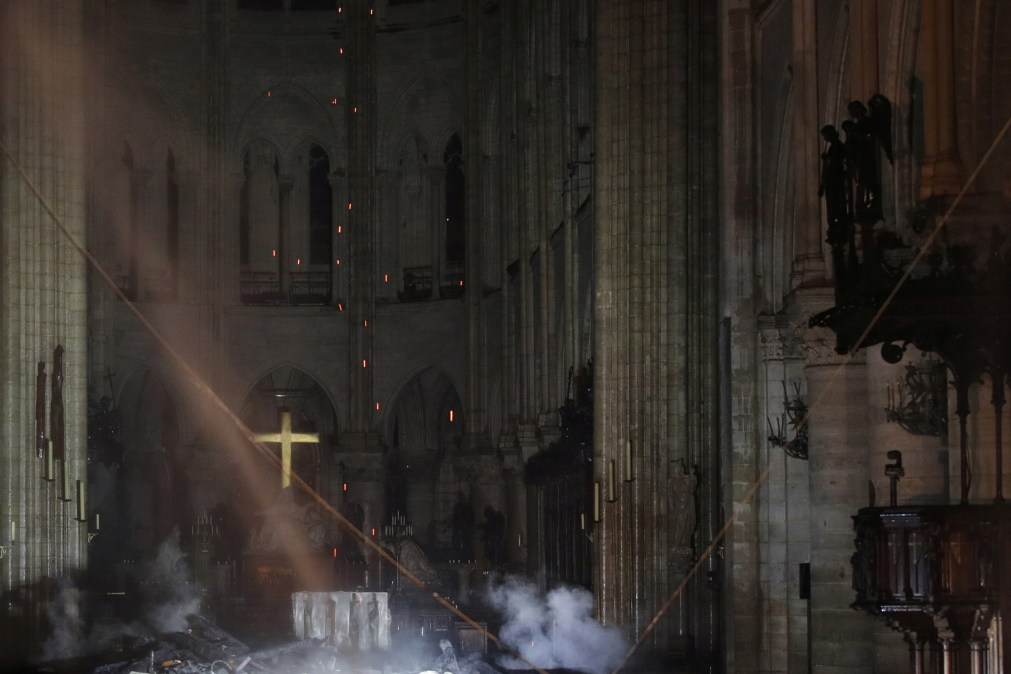 Smoke can be seen rising from the burnt remains inside Notre Dame