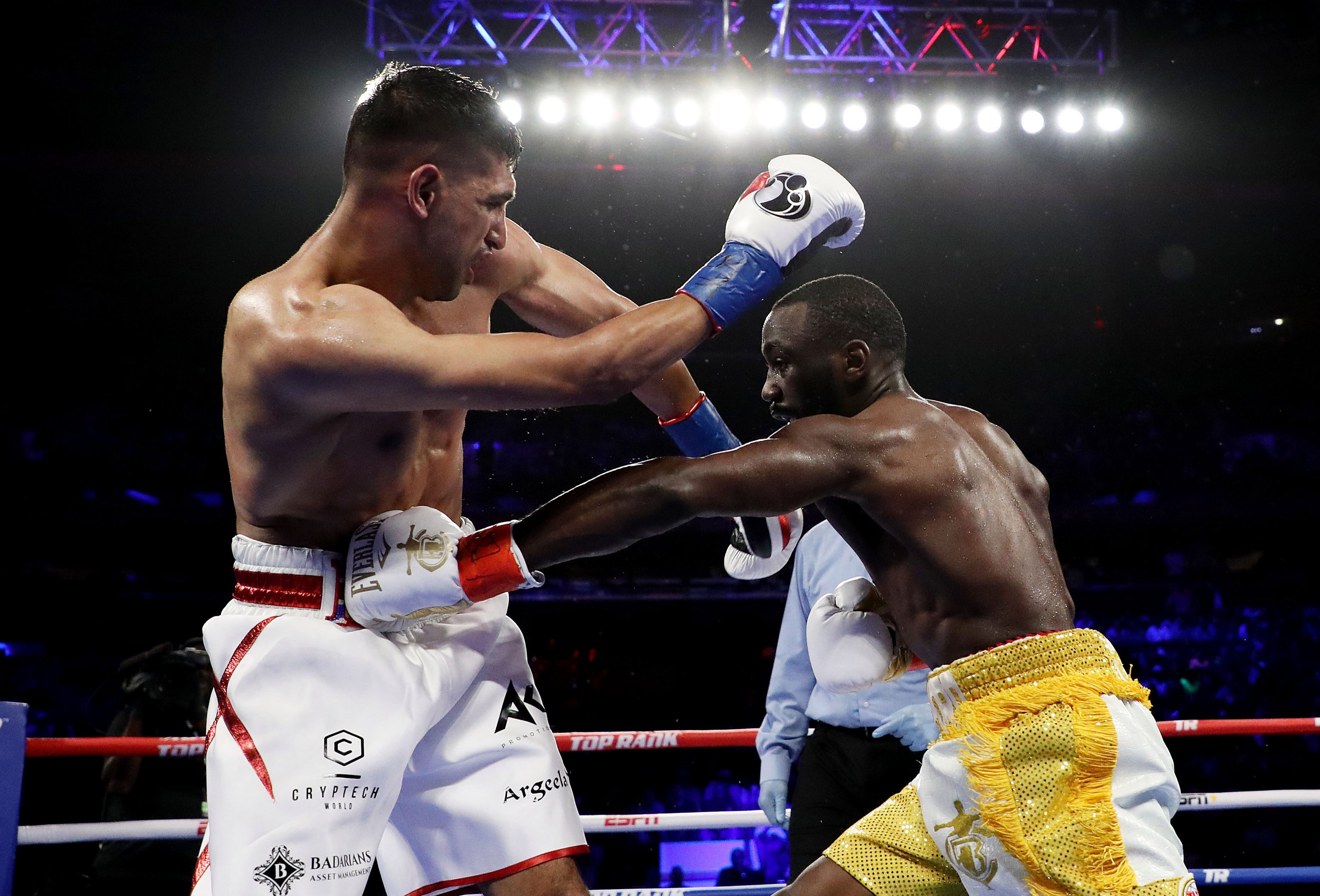 Crawford landed an accidental low blow on Khan and the Bolton boxer was pulled out by his trainer Virgil Hunter