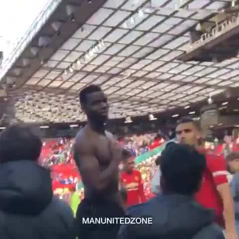 Pogba smiled and shrugged as he received abuse from some in the Stretford End