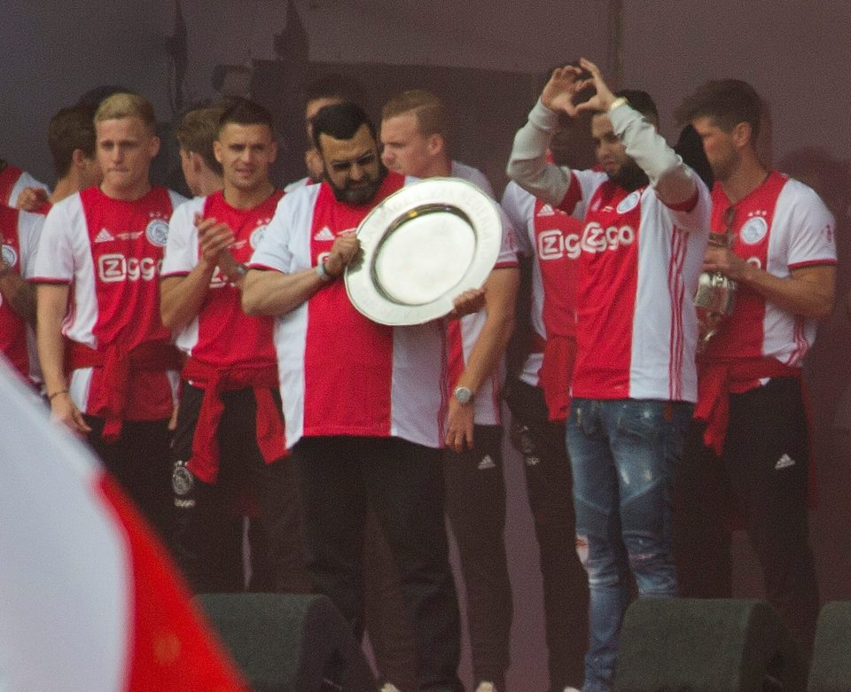 The midfielder's brother and father were invited on stage by captain Matthijs de Ligt, said a few words and lifted the two trophies won this season