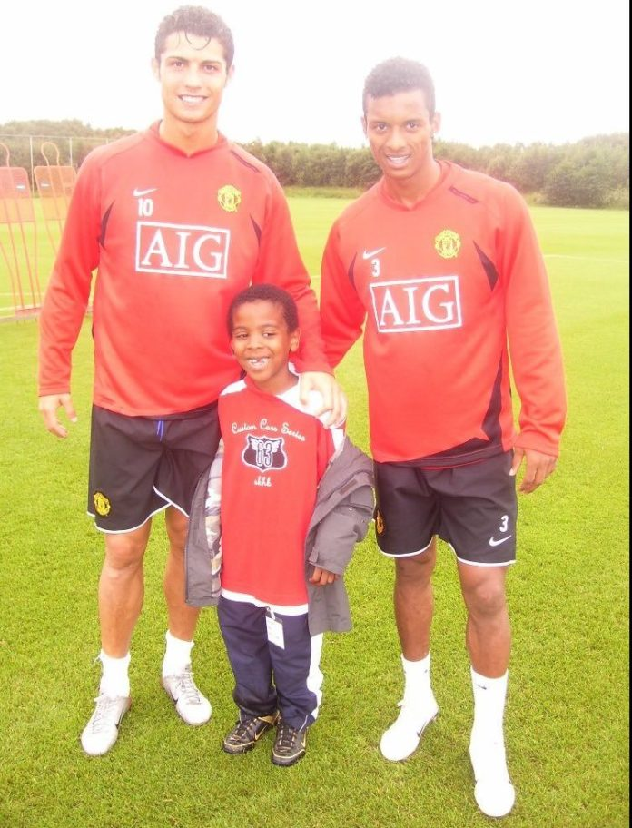Angel Gomes, a former United ball boy, poses with Cristiano Ronaldo and Nani