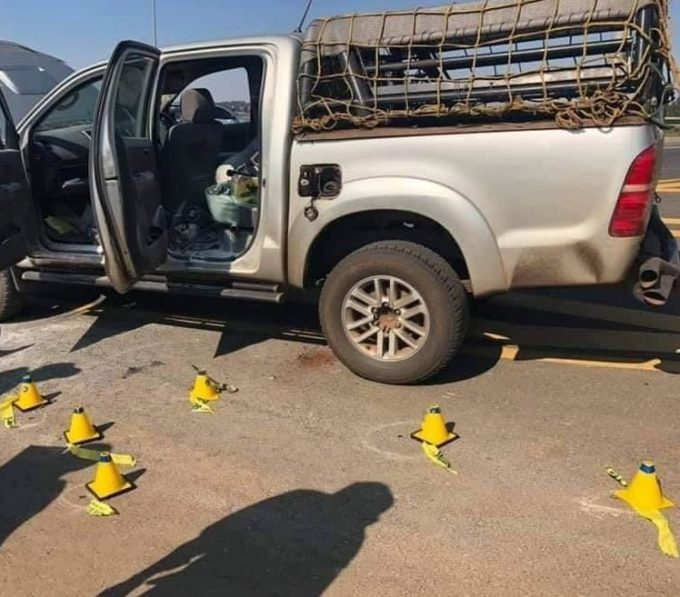 Cones mark bullet shells found at the scene of the horrific double murder
