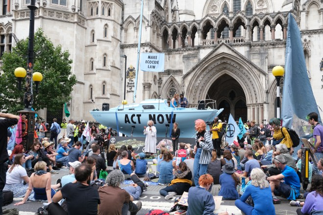 Extinction Rebellion block Fleet Street outside the Royal Courts of Justice as part of a new round of environmental protests, with their new blue boat