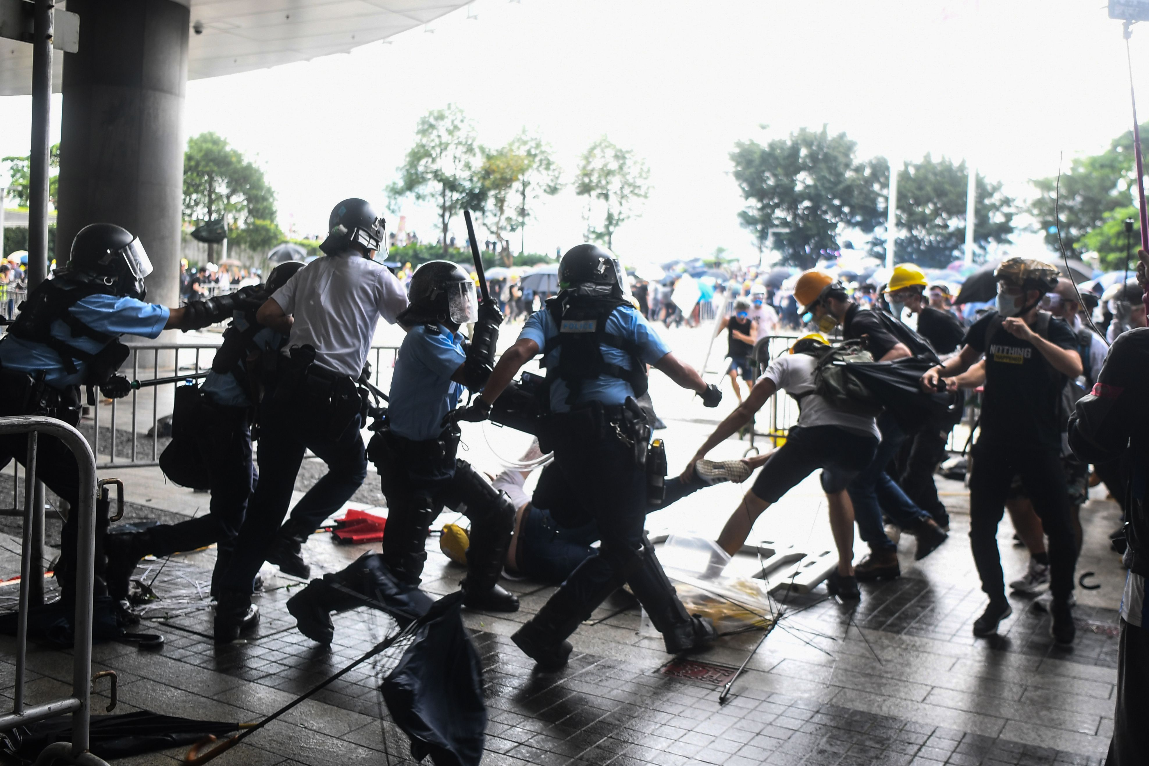 Protesters and police clashed in front of the Hong Kong legislature over new laws bringing them closer to China