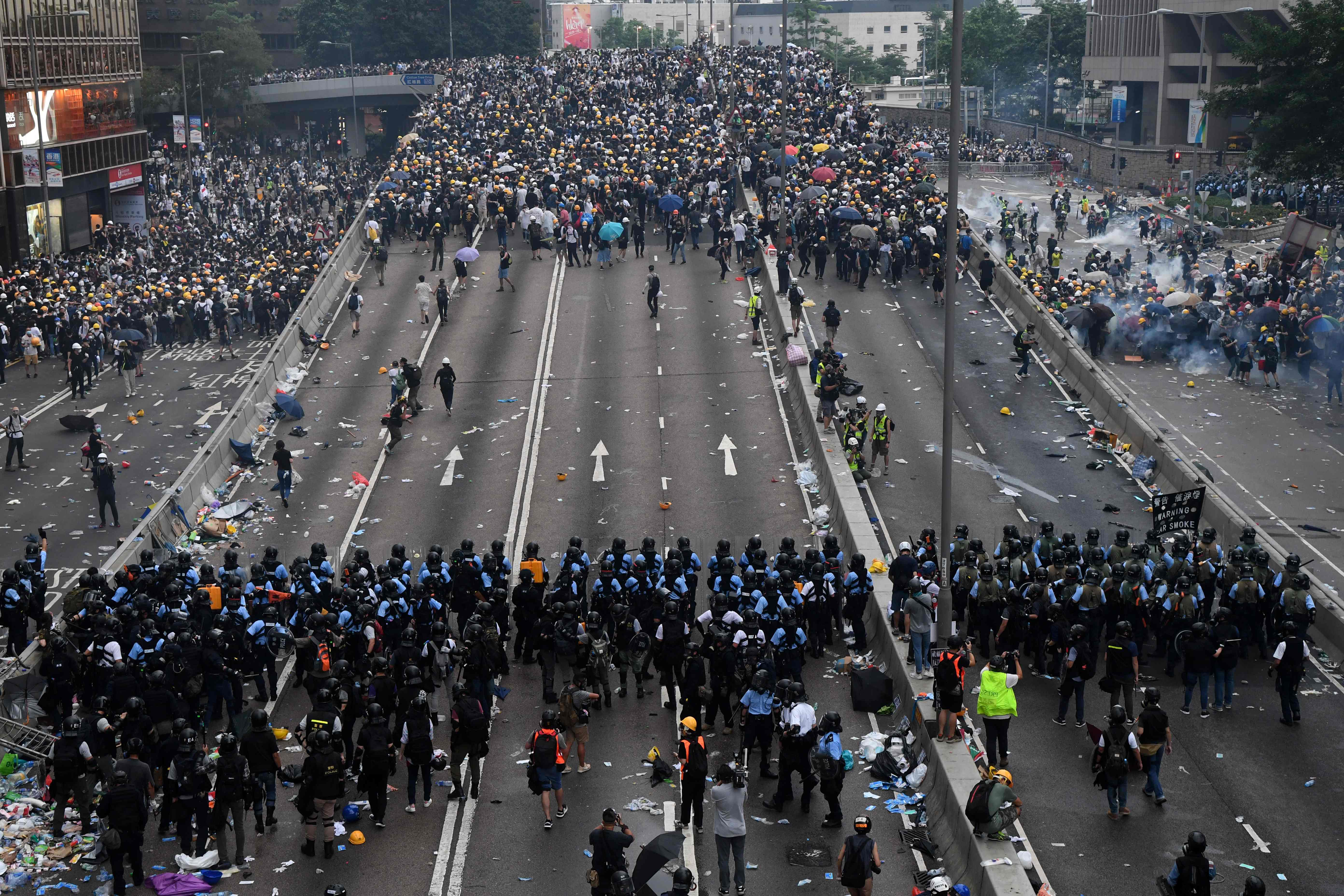 Protesters face off with police outside the Hong Kong parliament building