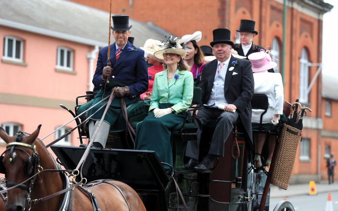 Racegoers in a horse drawn carriage during day one of Royal Ascot at Ascot Racecourse