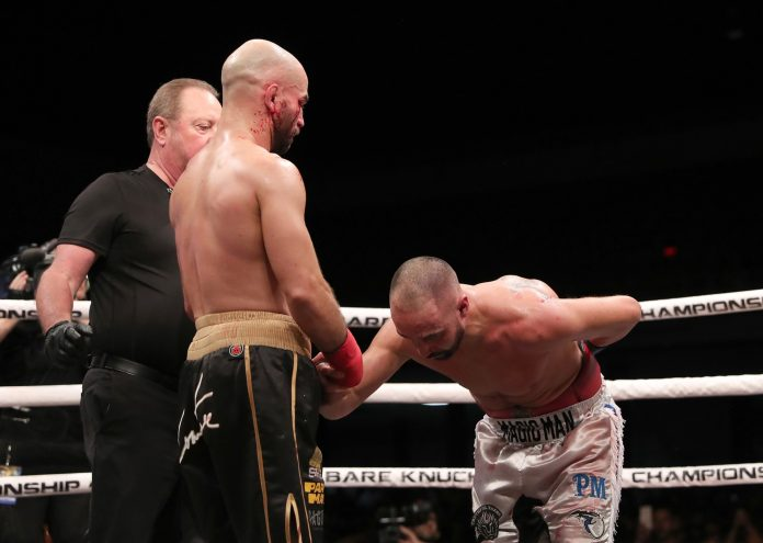 The American former boxer bows down in respect to his opponent in the ring in Florida