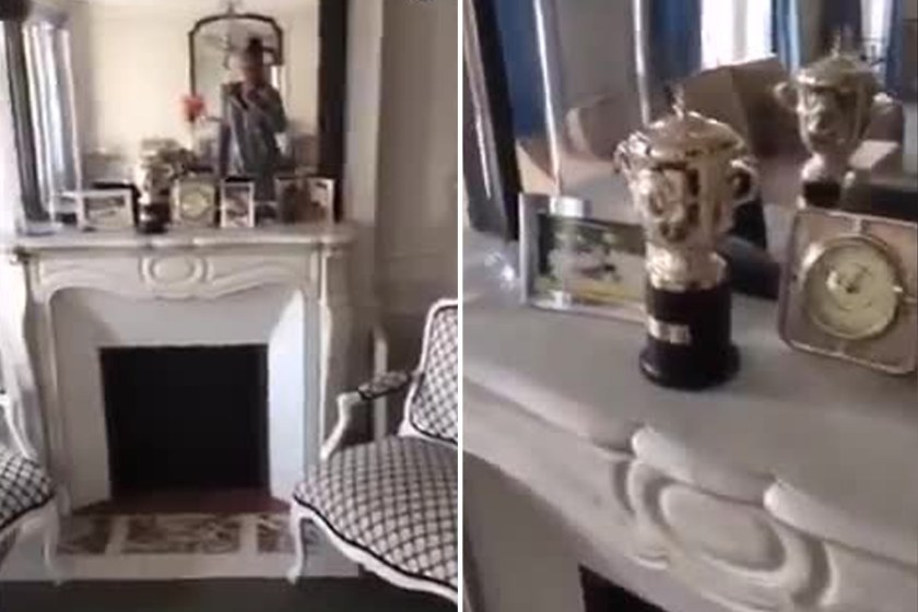 Tennis trophies sit proudly on display on Williams fireplace