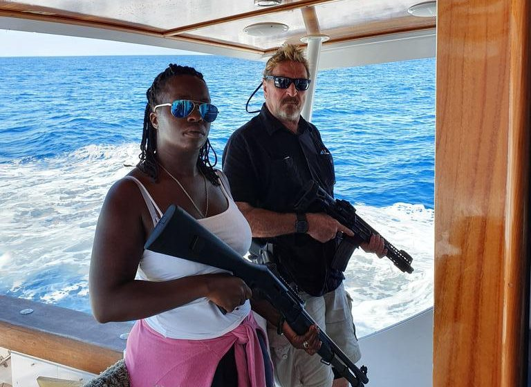 Gun-toting John McAfee wields a rifle on a yacht days before his 2019 arrest