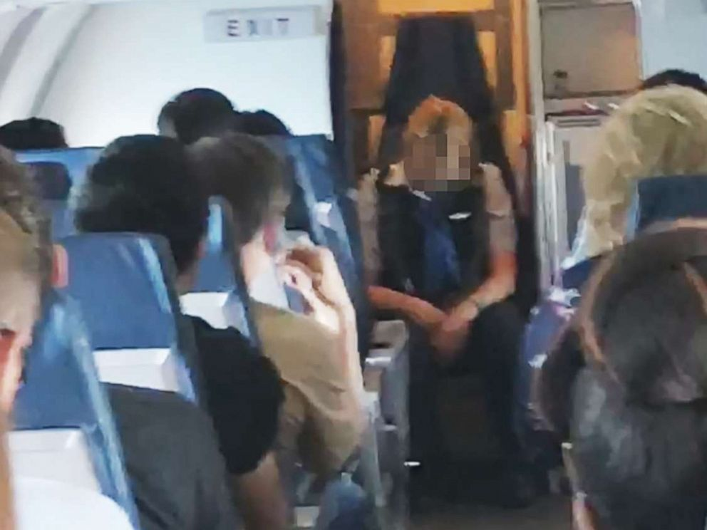 Drunk' flight attendant was so 'wasted' she passed out leaving worried  passengers to look after HER