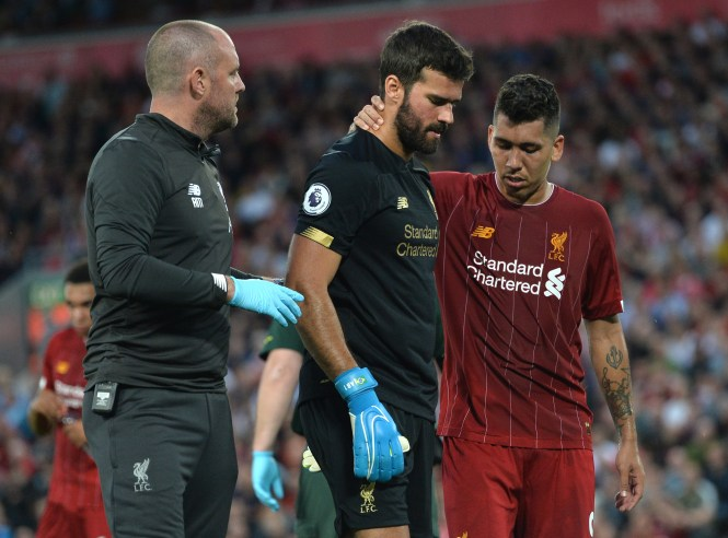 Countryman Roberto Firmino consoles Alisson as he is replaced by Adrian