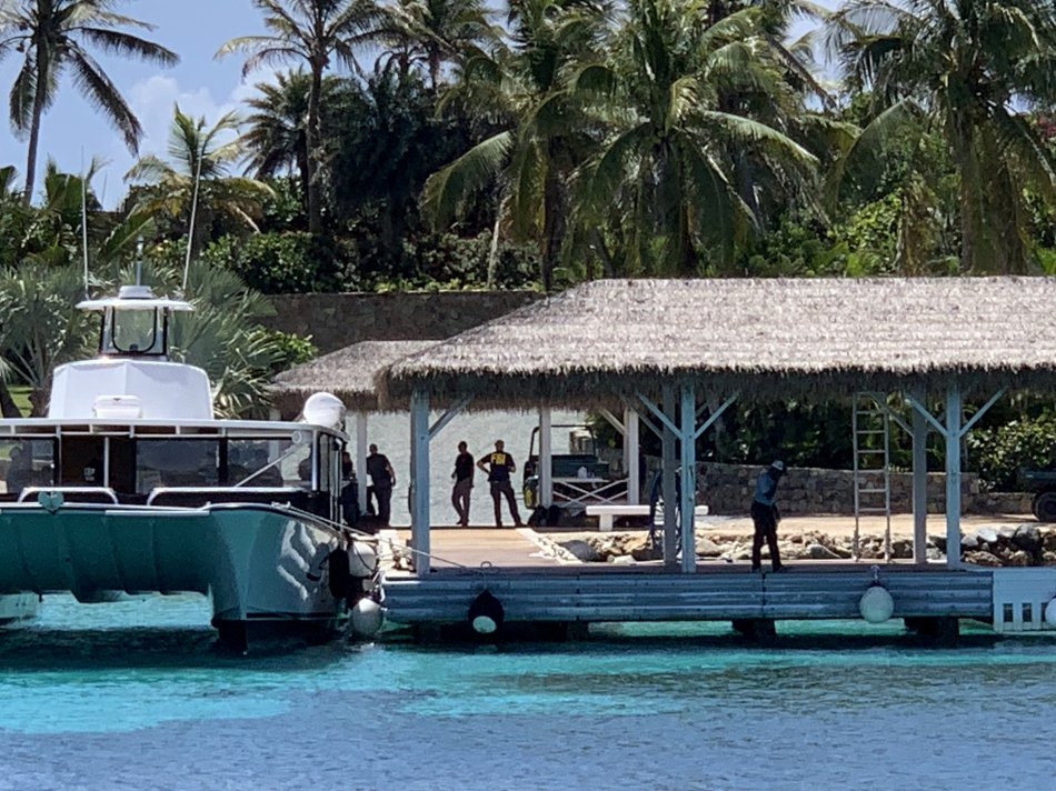 FBI officers can be seen arriving by speedboat at Jeffrey Epstein's 'paedo island'