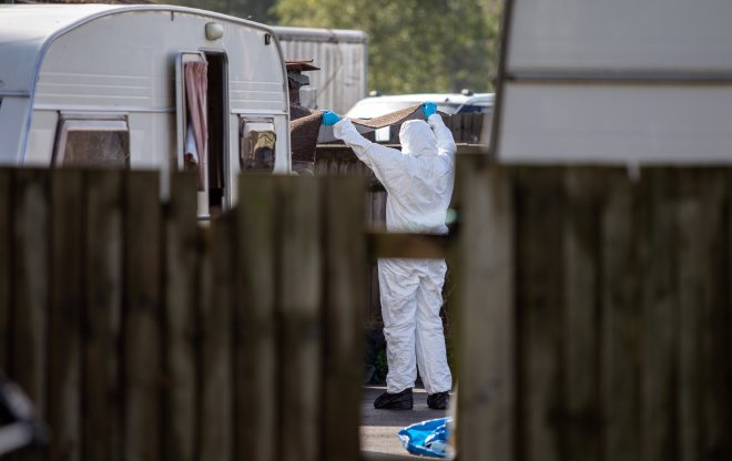 Forensics on the scene at the Four Houses Corner caravan site