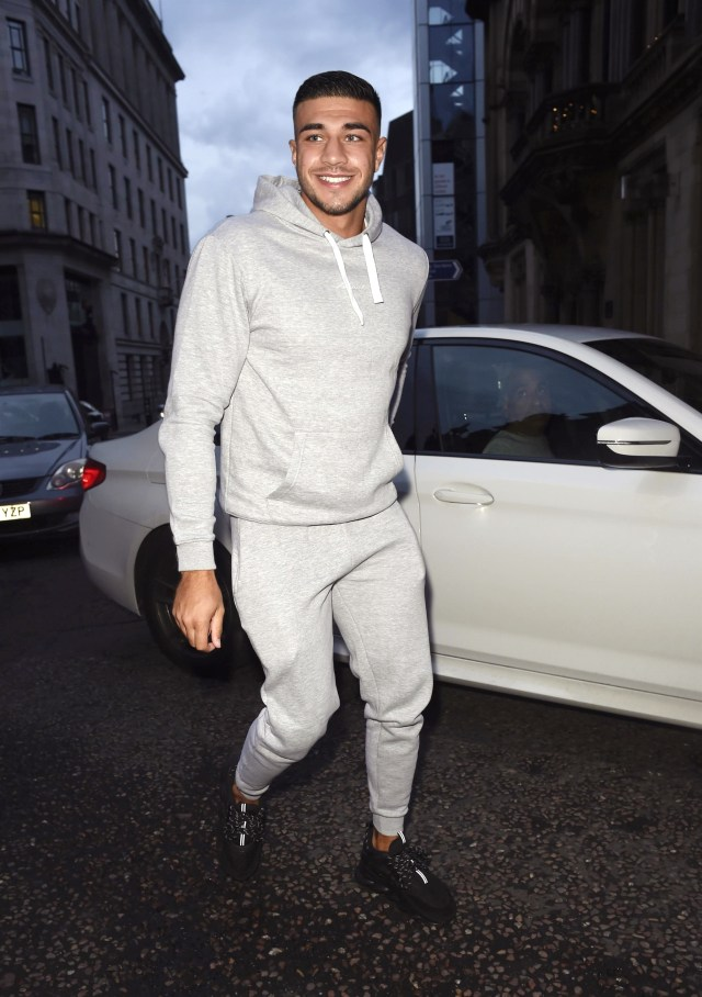 He donned a casual grey tracksuit for his night of partying