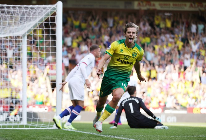 Todd Cantwell wheels away after levelling the score at 1-1 for Norwich