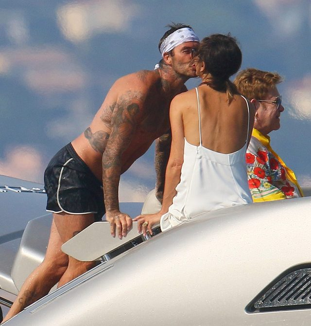 David kissed Victoria with Elton behind them on their European holiday