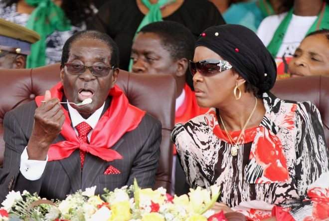 looks on next to her husband Robert Mugabe during his 91st birthday celebration in Victoria Falls