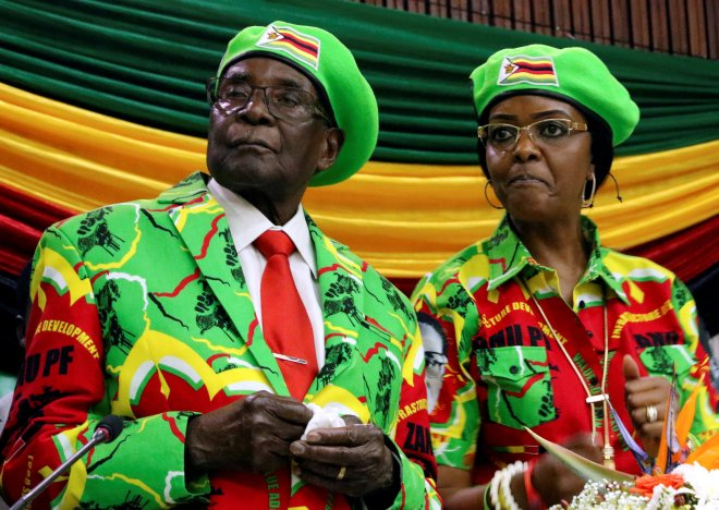 Zimbabwean President Robert Mugabe and his wife Grace attend a meeting of his ruling