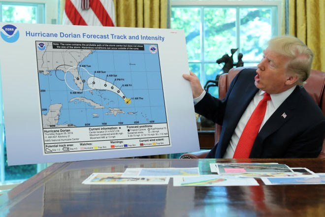 US President Donald Trump presents his map showing Hurricane Dorian's projected path