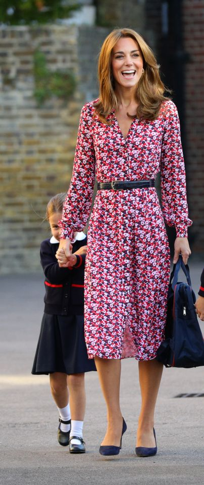Charlotte hides behind her mum Kate as she arrives