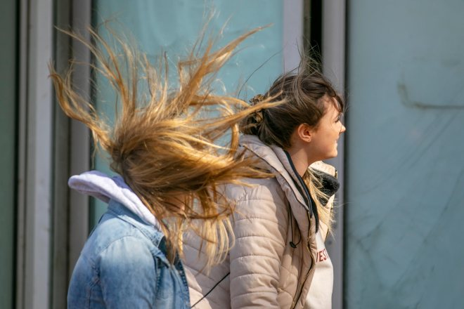 Strong winds whip two women in Blackpool on Friday