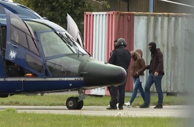 Abdi is escorted to a police helicopter in Hamburg last week