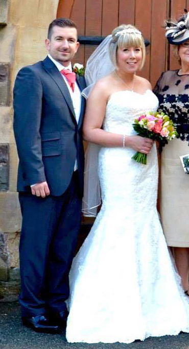 Lawrence with his wife Kelly on their wedding day