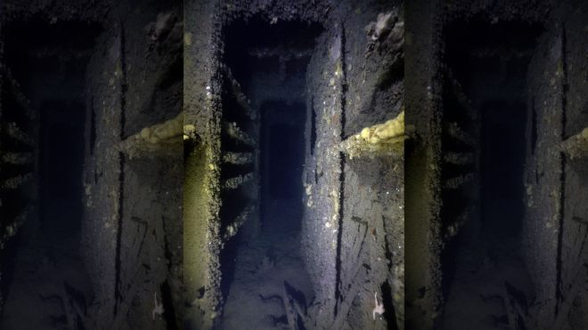 The inside of the sunken ship is glimpsed