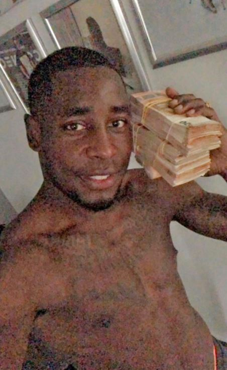 This selfie taken by former Dutch professional soccer player Kelvin Maynard shows him with a stack of bank notes