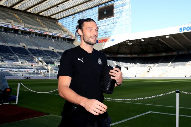 Andy Carroll beams with happiness as he arrives for the game against Brighton