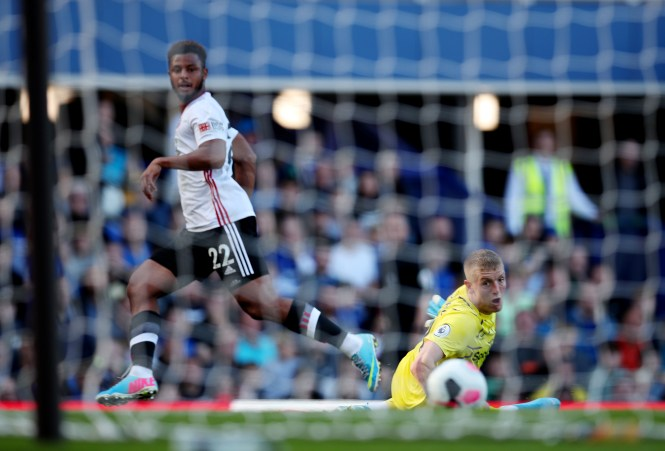 Mousset slips the ball past Jordan Pickford to scored United's second