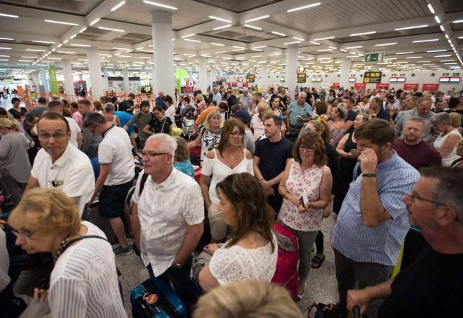 Hundreds of holidaymakers queue at Son Sant Joan airport in Palma de Mallorca after Thomas Cook collapsed