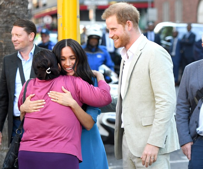 Meghan beamed and appeared to enjoy the hug