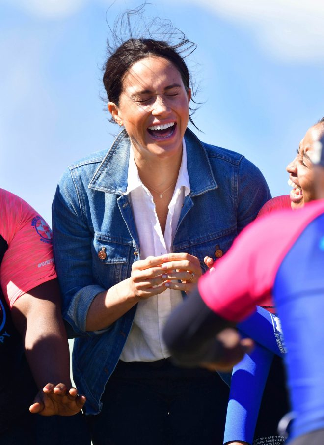 Meghan Markle bursts out laughing as she spends time with the young men and women