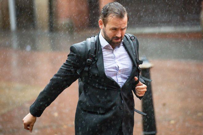 A man runs through heavy rain in Birmingham city centre