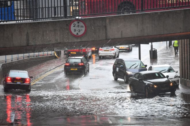 Cars try to make their way through a flooded road in Birmingham city centre