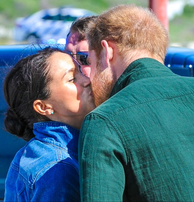 The couple looked loved-up as Harry gave Meghan a kiss